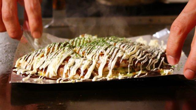 Okonomiyaki, Omu-Curry, die 2000-Yen-Note und ein futuristisches Museum